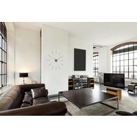 Mini Merlín wandklok in minimalistisch design