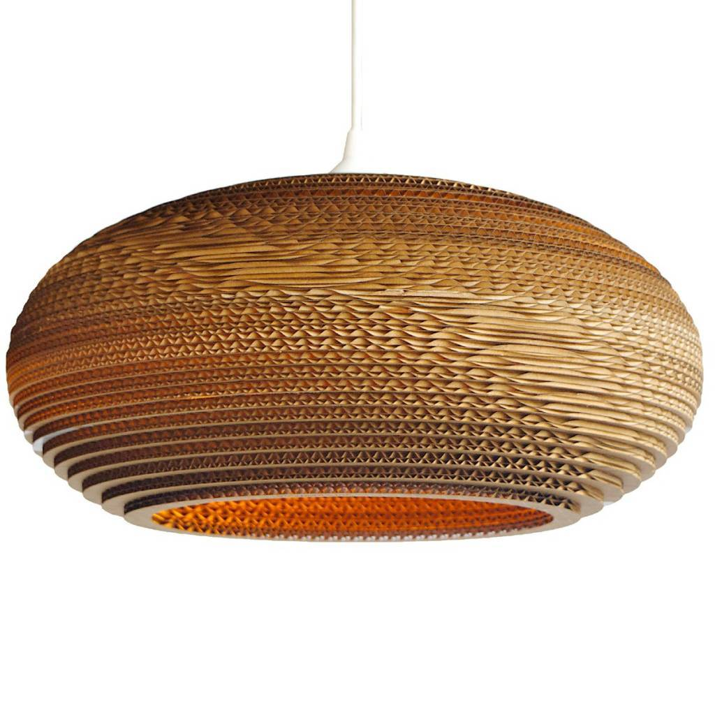 we love these lamps by gray pants this brown lamp made of recycled cardboard is a real eyecatcher this disc hanging lamp is pleasant light