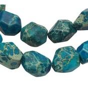 Turquoise Regalite Jasper geslepen turquoise blauw ±15x12mm