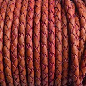 Oranje Rondgevlochten leer orange pink 4mm - prijs per 10cm
