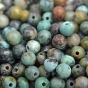 Grijs Edelsteen kraal African turquoise rond 4mm - 10 stuks