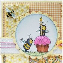 Sello de goma, abejas, una vela y una magdalena / de la magdalena