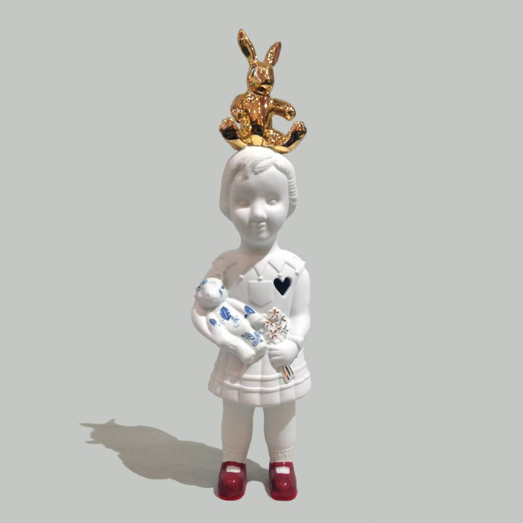 Porcelain doll with gold rabbit