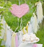 A Little Lovely Company diy tassel garland slinger pastel