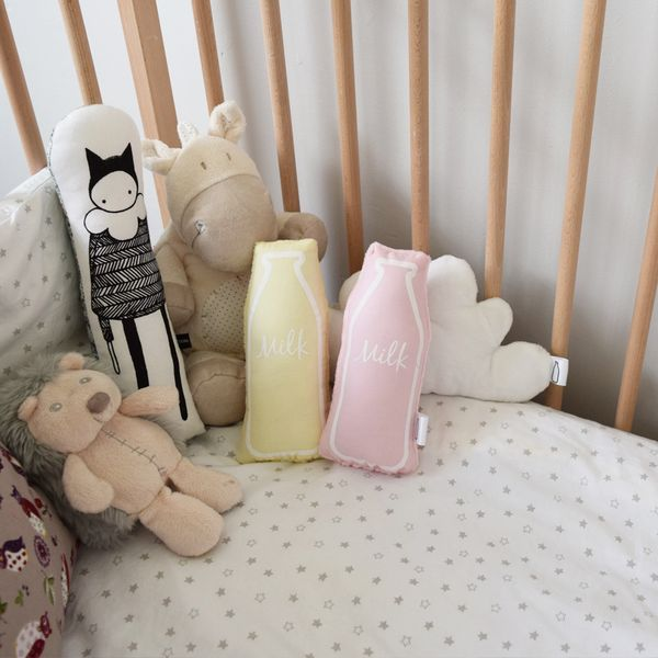 The Milk Collective pink baby rattle