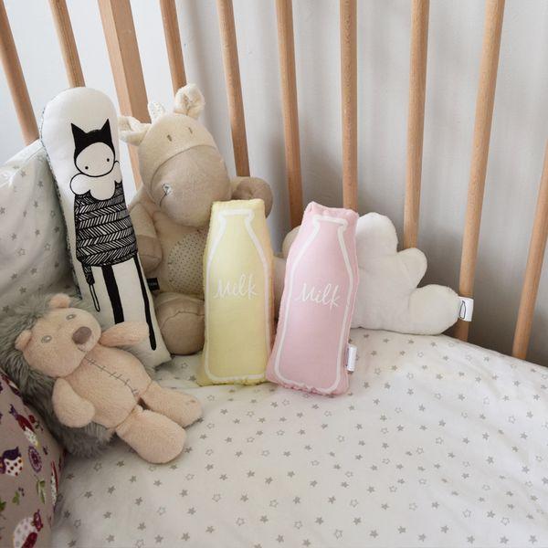 The Milk Collective baby rammelaar geel