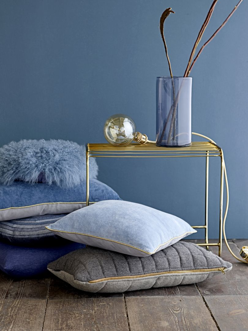Decoreer je huis met kussens en vloerkleden