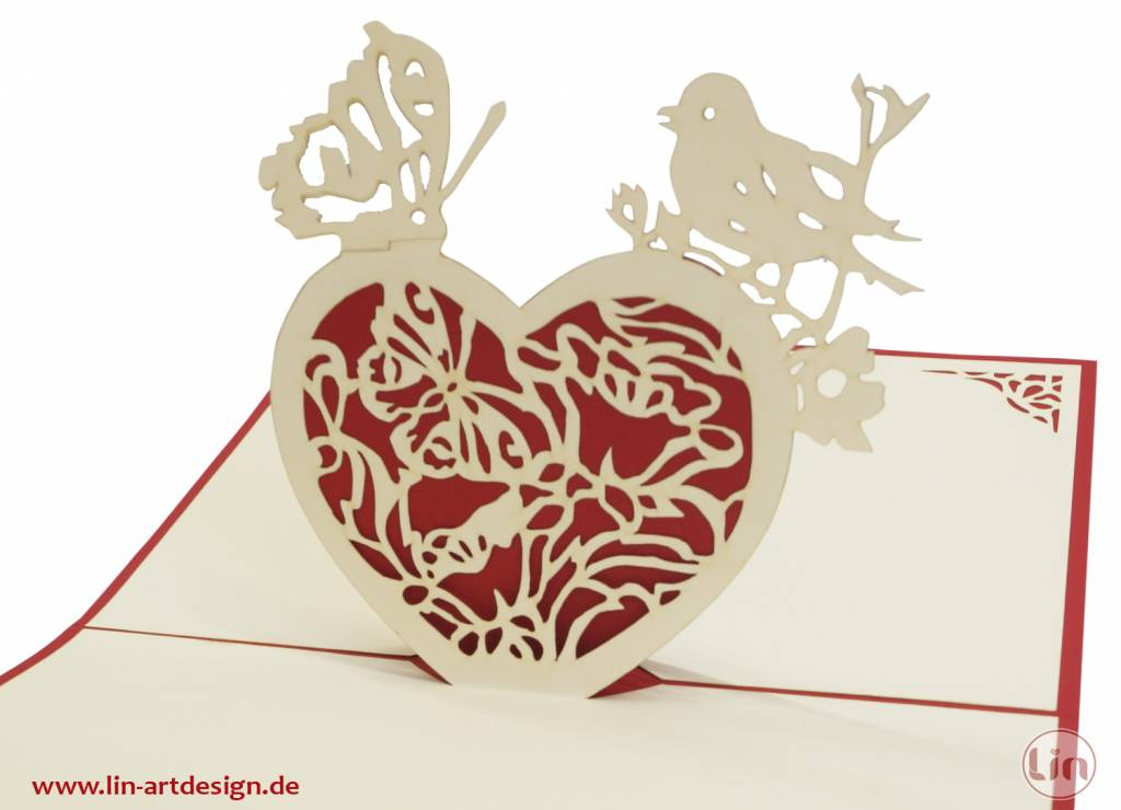 Heart with butterfly and bird