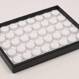 Stapellade mit 40 runden Kunststoffdosen