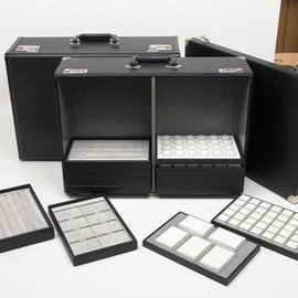 Karat sample case with metal corner pieces and racks for sliding trays