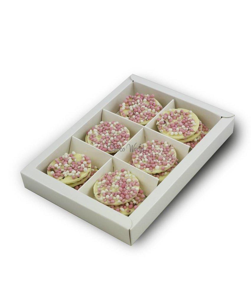 Geboorte flikken wit met roze muisjes