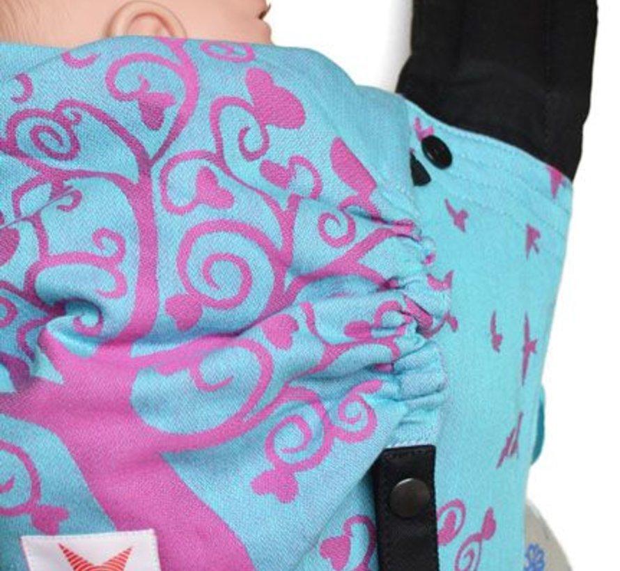 Draagzak Kokadi Flip Erna Im Wunderland, roze met blauwe drager met hertjes.