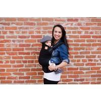 Draagzak Tula Urbanista effen zwarte draagzak voor baby en peuter dragen.