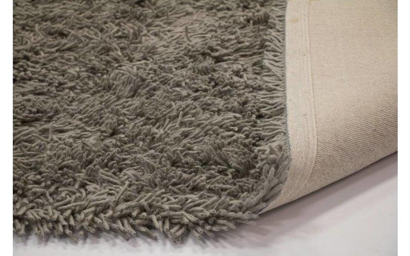 Prachtig hoogpolig wollen vloerkleed in grijze kleurstelling