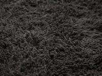 Prachtig antraciet hoogpolig vloerkleed van wollen garen