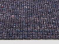Vloerkleed van 100% wol in paarse kleurstelling