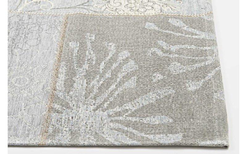 Patchwork vloerkleed met prachtig bloemendessin in het lichtblauw