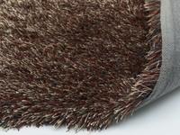 Chester 62 - Rond hoogpolig vloerkleed met een mix van bruine en rode garen