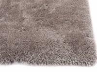 Hoogpolig vloerkleed in mix grijze kleurstelling