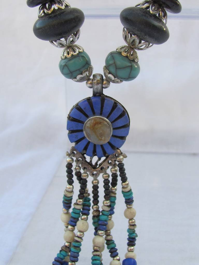 Necklace with beaded tassel and blue medallion