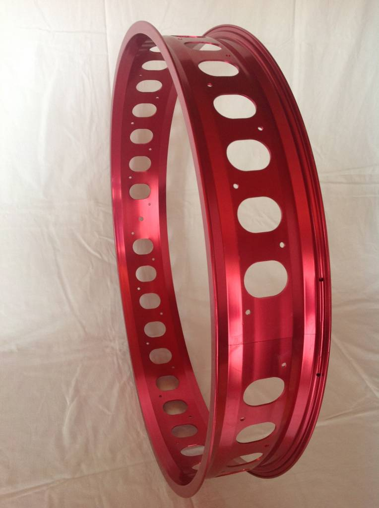 "cut-out rim RM100, 26"", red anodized, 32 spoke holes, round cut-outs"