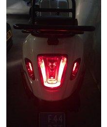 LED Smoke achter knipperlichten Vespa Primavera en Sprint met dagrijverlichting