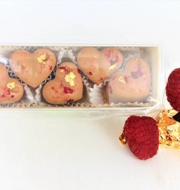Chocolate hearts with raspberries and gold leaf