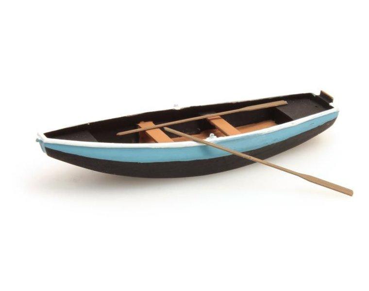 Stalen roeiboot blauw