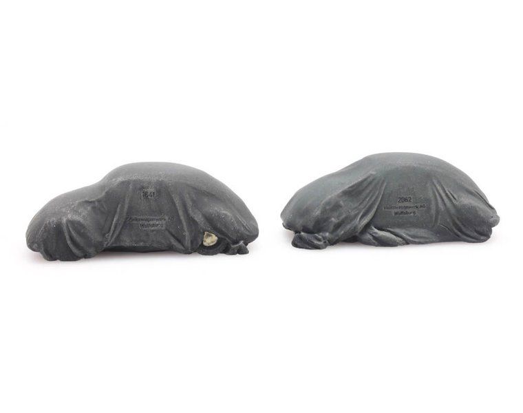 Chargo: Two VW Beetles under tarpaulin