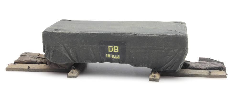 Cargo: Shipping crate under tarpaulin