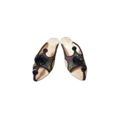 Orientalische Leder-Pantolette mit Pompons in Schwarz