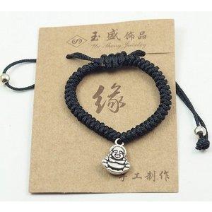 Armbandje met boeddha bedeltje.