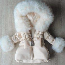 Creme winterjas inclusief bontkraag met strik riem