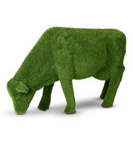 Grazende koe van kunstgras