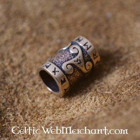 Brązowy broda kulkowym trisqelion i runa napisem