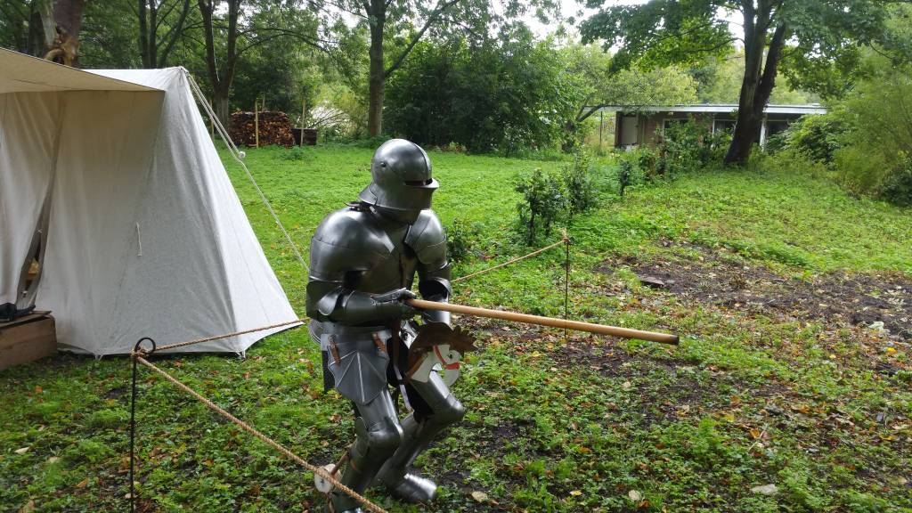 15th century knight preparing for the joust during a kids-event
