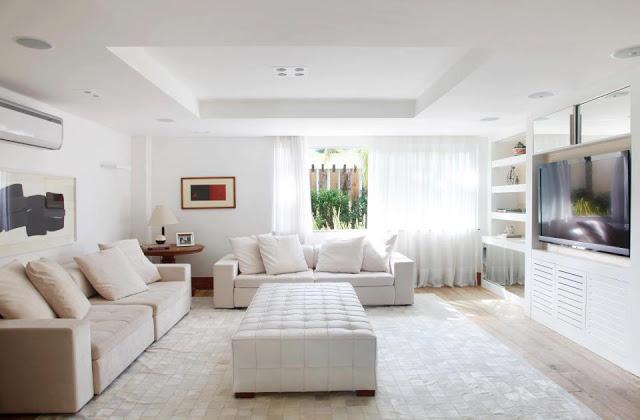 ... woonkamer. Ook gaan neutrale en antieke meubels goed samen met deze