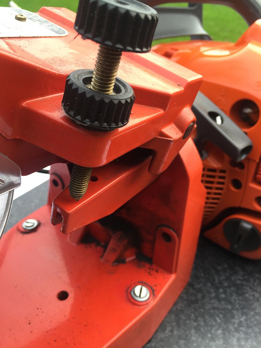 Elektrische kettingslijper ketting instellen