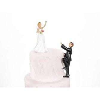 Taarttopper klimmende bruidegom