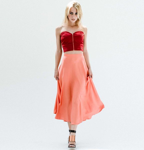 This is Lily Flared midi skirt in pinky coral