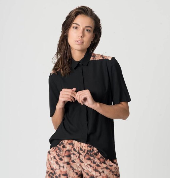 This is Lily Blouse of black viscose with feather print