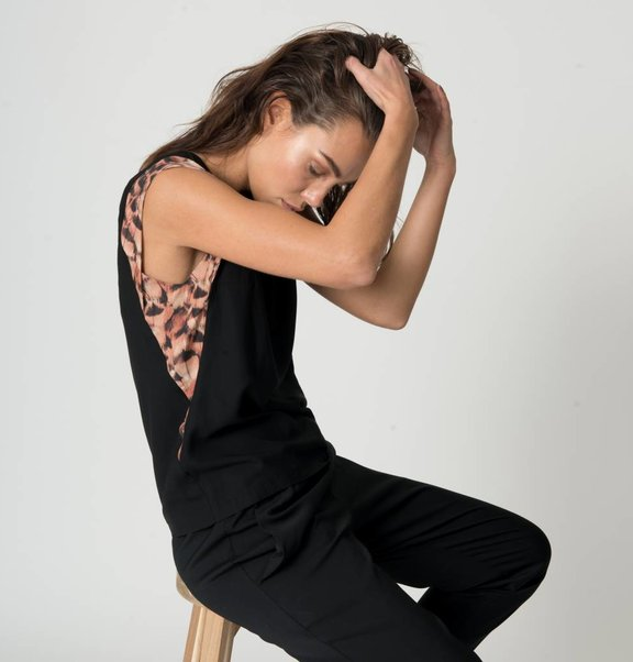 This is Lily Top from black viscose with Feather print