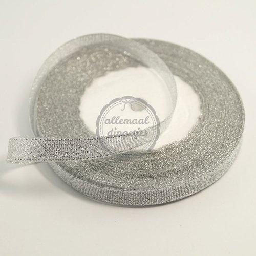 Lint glitter zilver 10mm (rol van 22 meter)