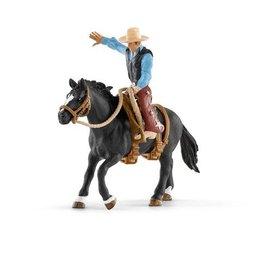 Schleich Western cowboy in het zadel - 41416