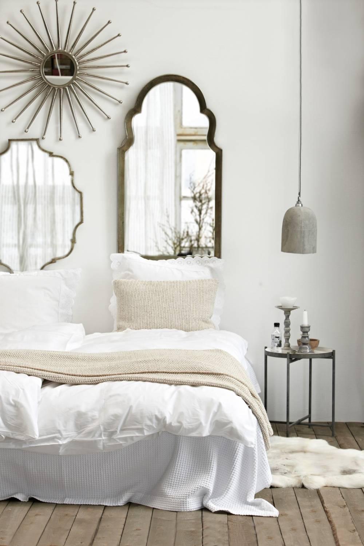 In deze slaapkamer wordt veel gewerkt met natuurlijke materialen en ...