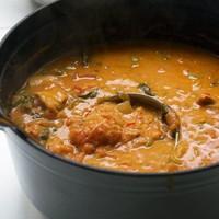 Pindakaasdag recept: Moambe Nsusu (kip met pindasaus)