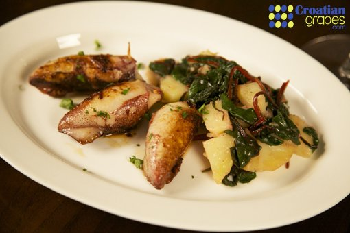Squid stuffed with Prsut (smoked ham) and cheese