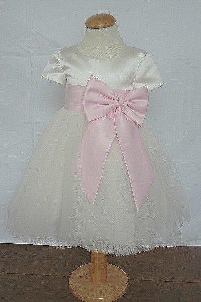 Bruidsmeisjes jurk Margriet ivoor met roze strik