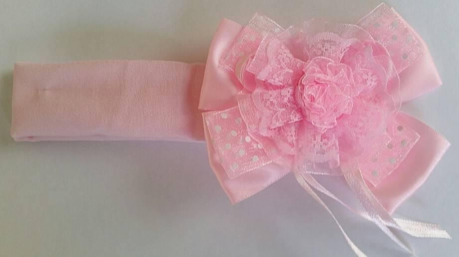 Tricot haarbandje met roze roos