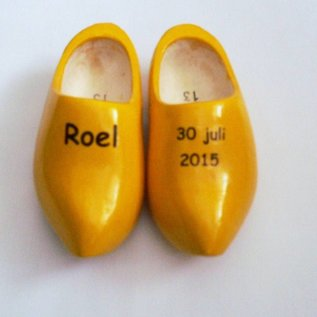 birth clogs with a name and date or an image.